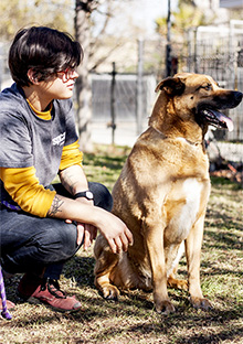 spcaLA animal care attendant with dog