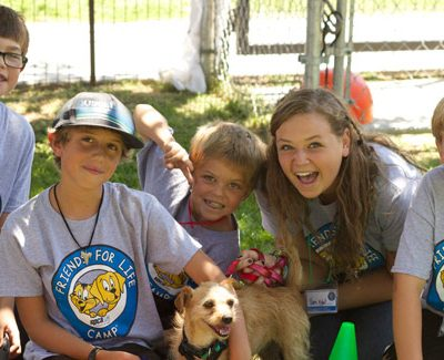 5 spcaLA campers outside with a shelter dog