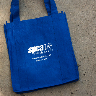 Blue tote bag with white spcaLA logo and text 'www.spcaLA.com (888) spcaLA1'