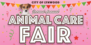 City of Lynwood Second Annual Animal Care Fair text. Pink background with confetti and colored banner. Brown and white dog perched on top of text